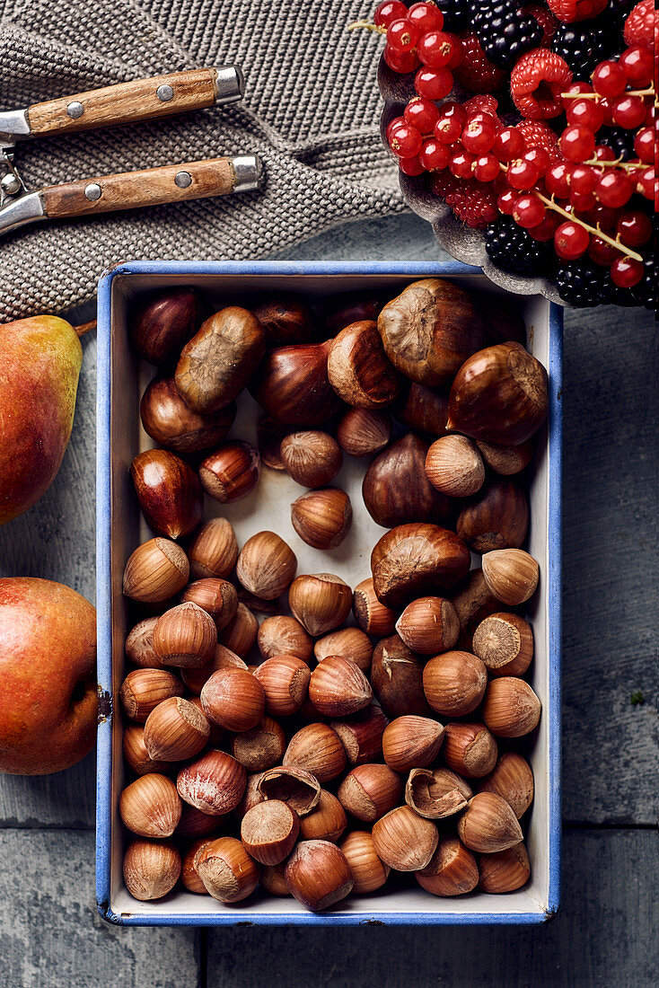 Chestnuts, hazelnuts, fresh berries and pears