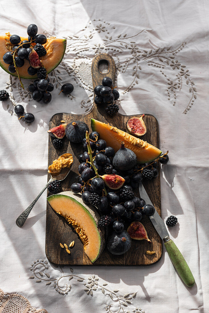 Fruits on old wooden chopping board