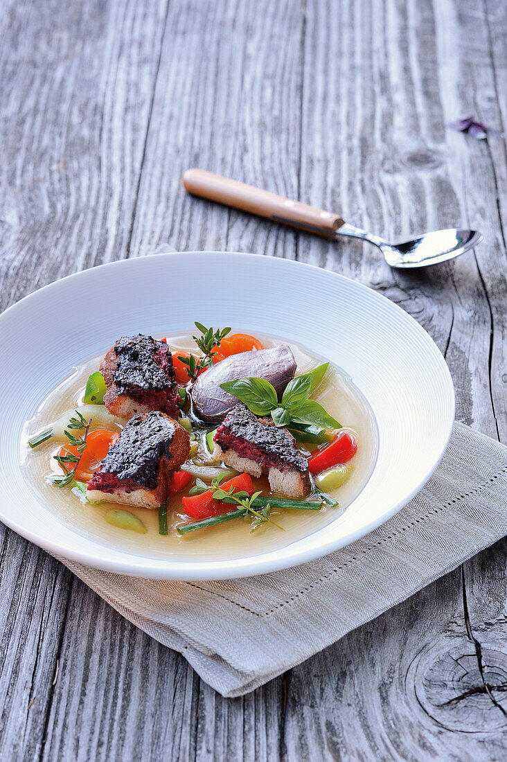 Crow breast and spleen slices in a game consommé