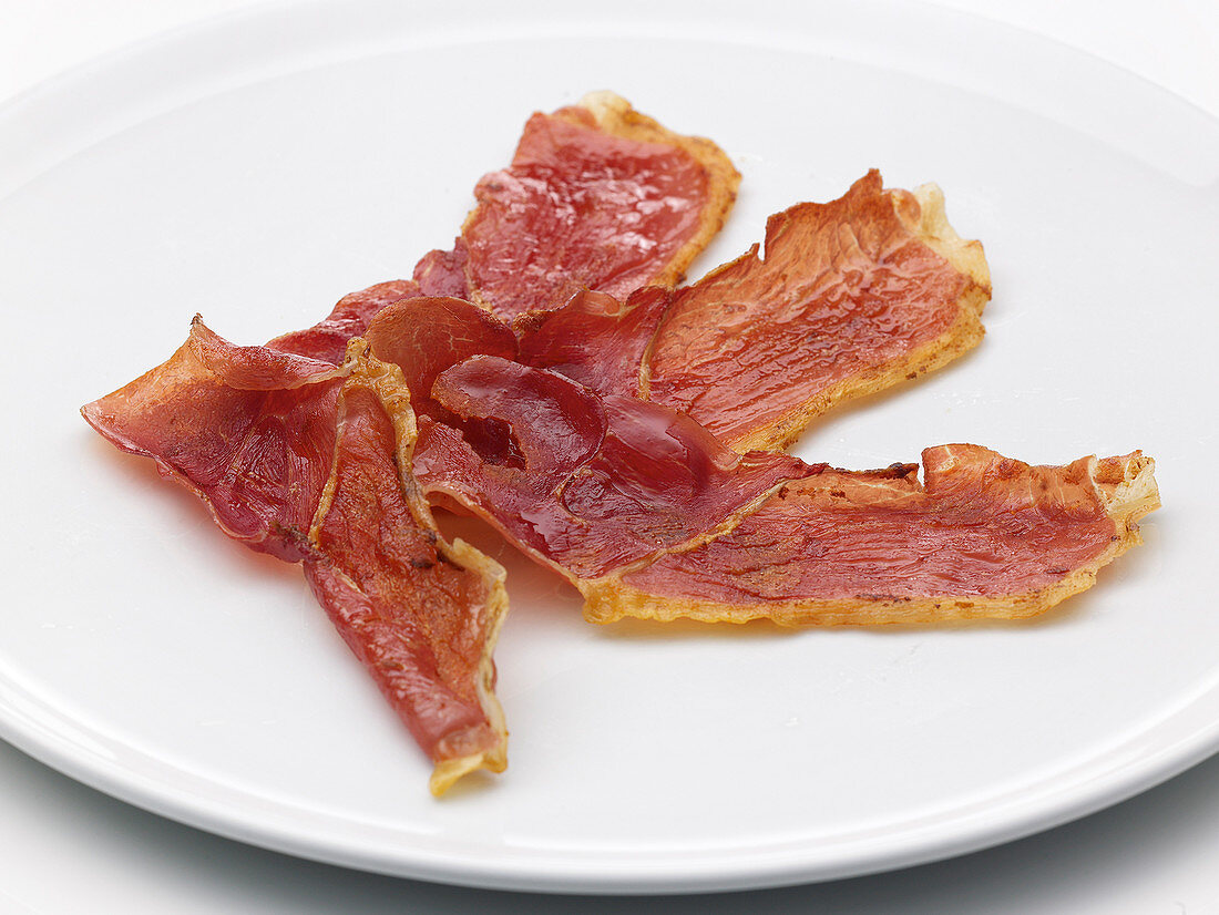 Slices of dried ham on a plate