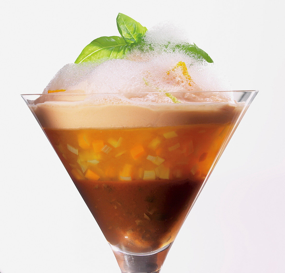 Saffron and tomato jelly with chopped vegetables in a dessert glass