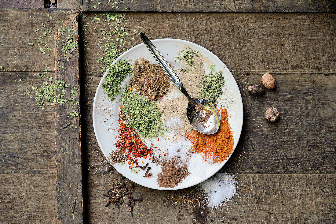Sausages being made: various spices and herbs on a plate