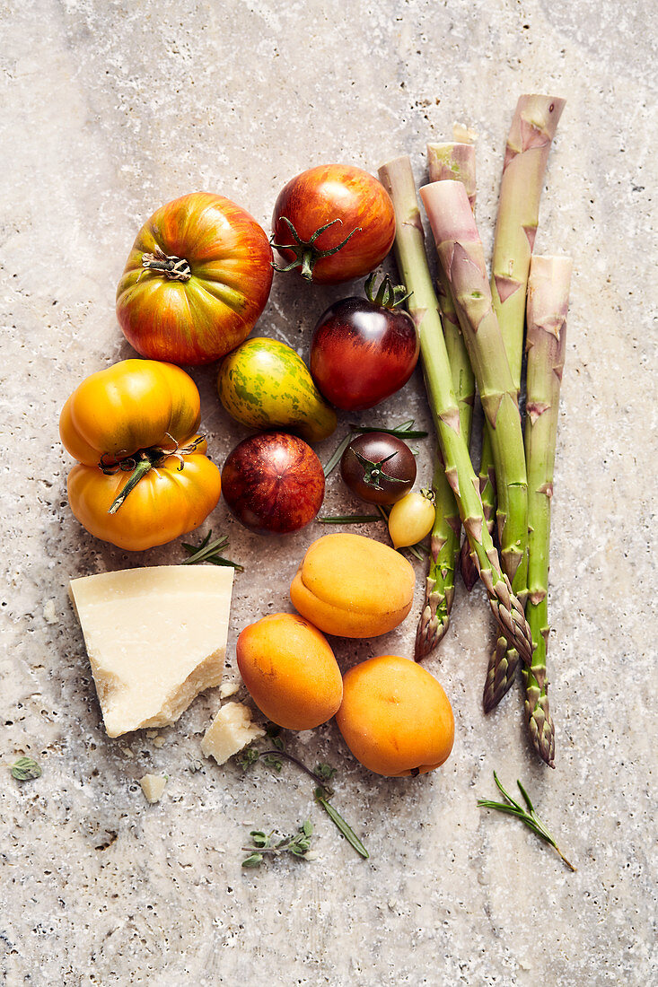 Mediterranean snacks (tomatoes, asparagus, apricots and cheese)