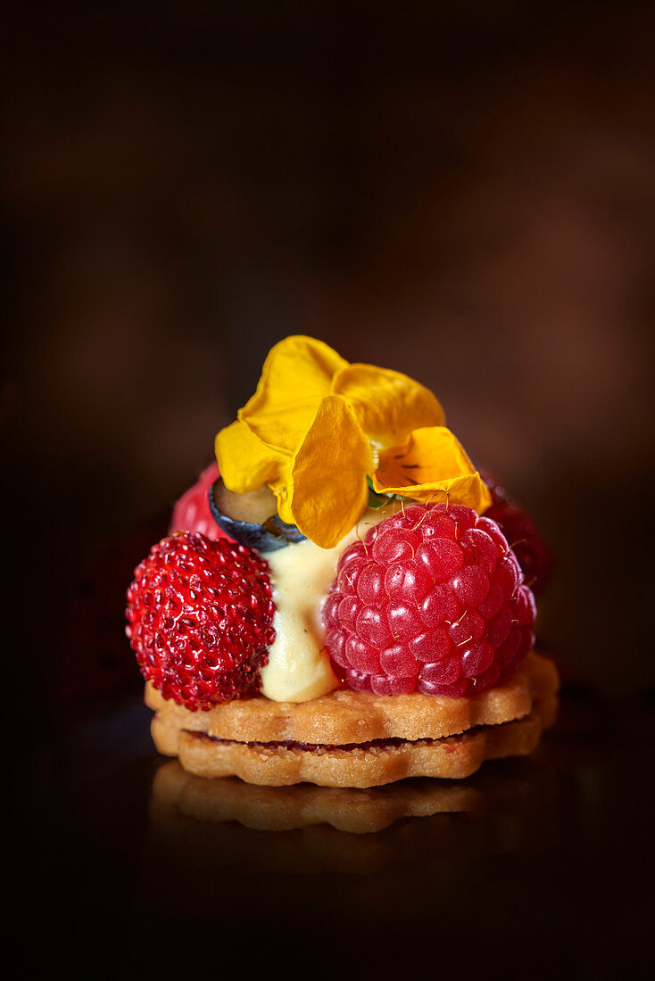 A fruit tartlet with edible flowers