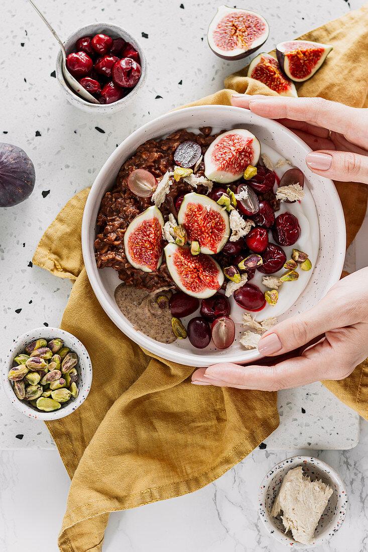 Porridge with halva, figs, pistachios and fruit