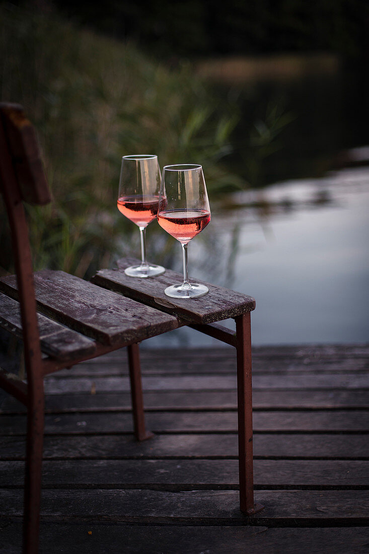 Glass of rose by the lake