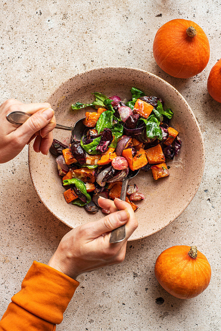 Mixing Autumn vegetable salad