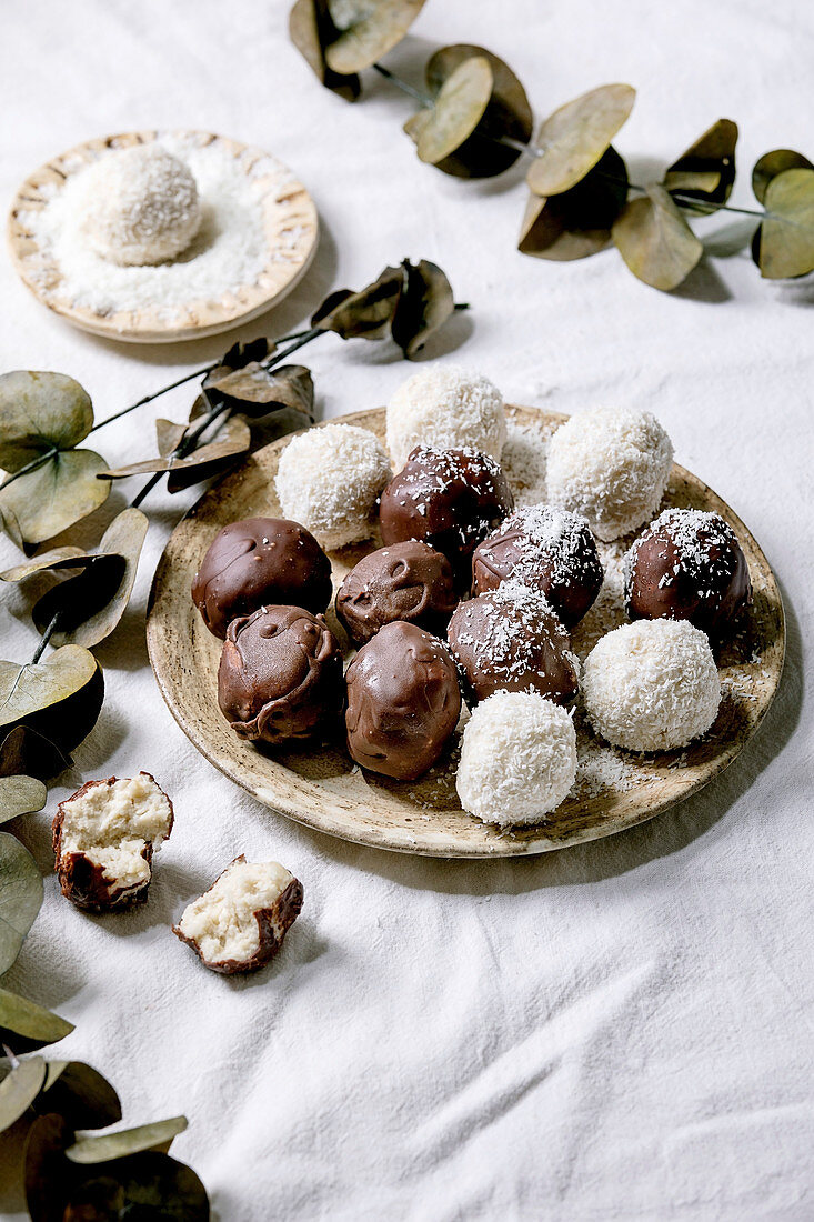 Raw vegan coconut chocolate candy balls with coconut flakes