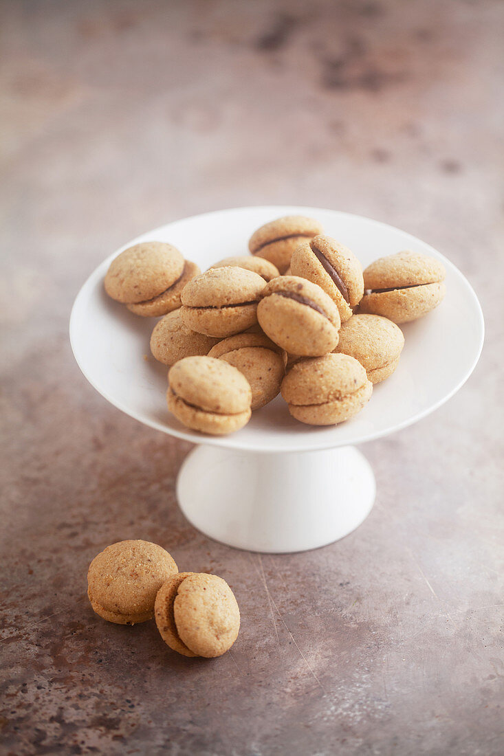 Baci di dama (Italian hazelnut biscuits) on a cake stand