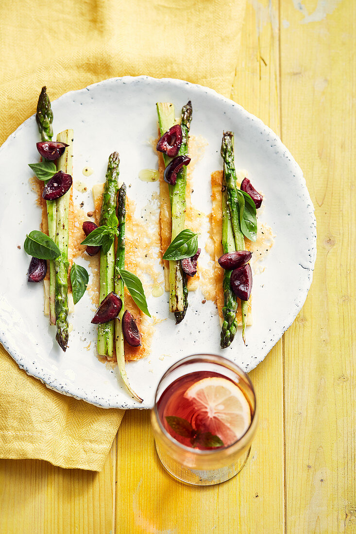 Green asparagus with cherries, basil and Parmesan puff pastry