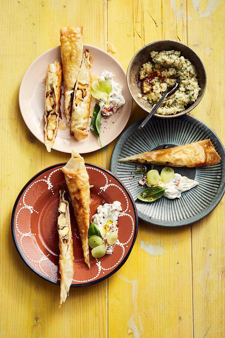 Halloumi and grape filo pastry rolls, sultana yoghurt and artichoke pesto
