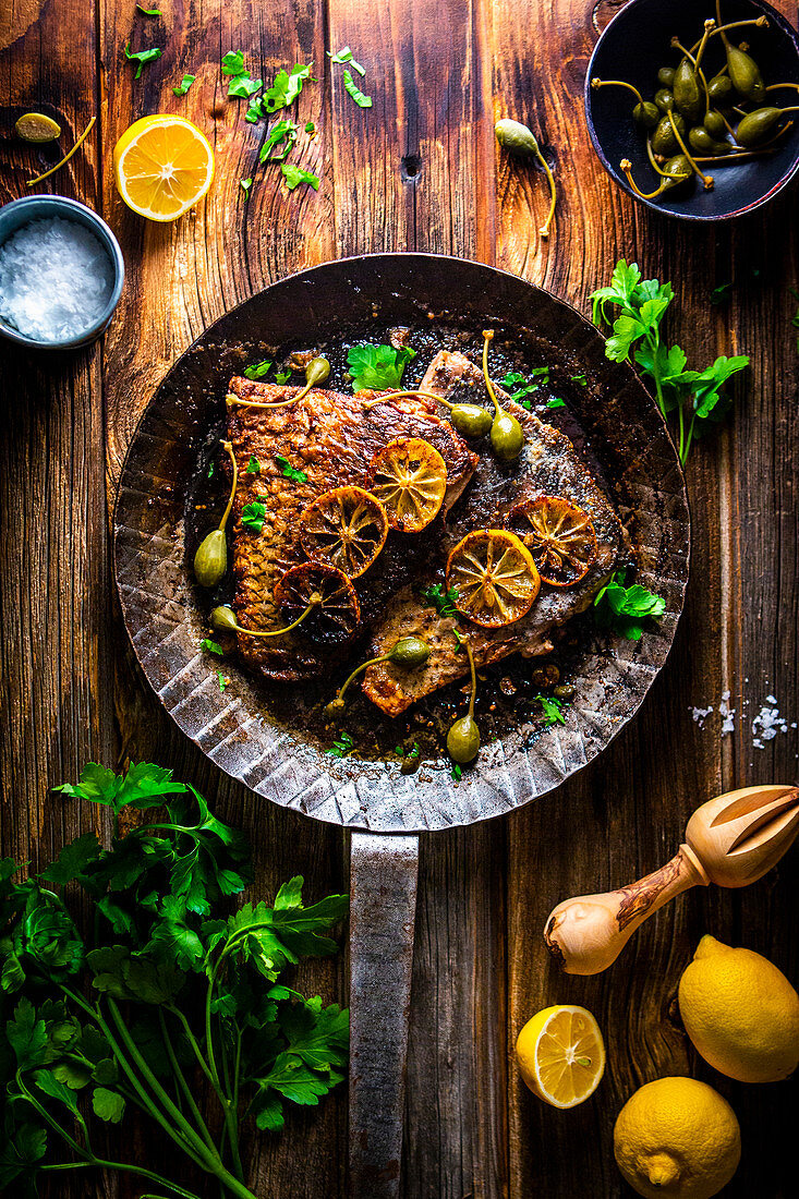 Carp with lemon butter and capers