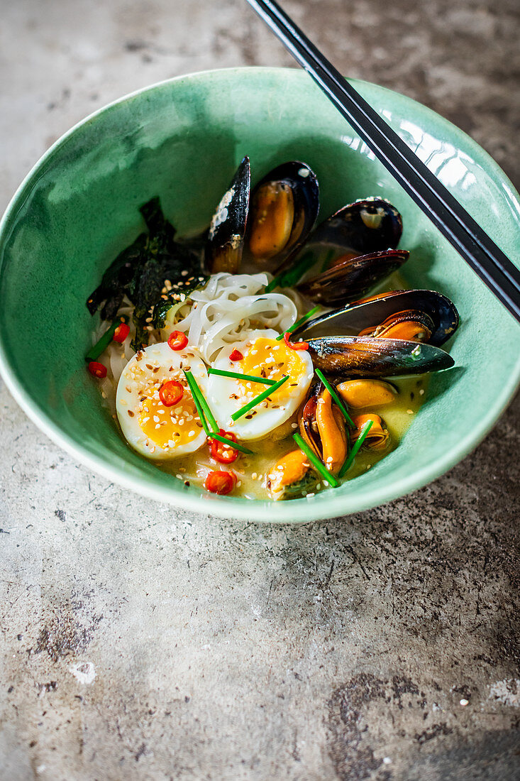 Poached mussels served Ramen style