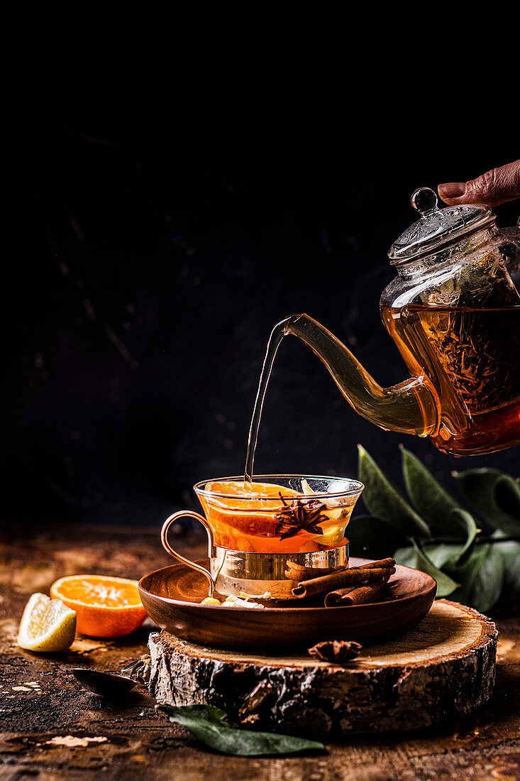 Warming tea with orange and lemon spices and honey