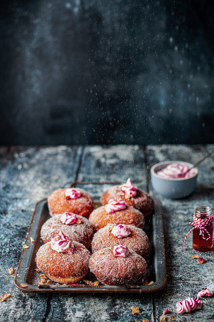 Vegan donuts with rose cream and jam