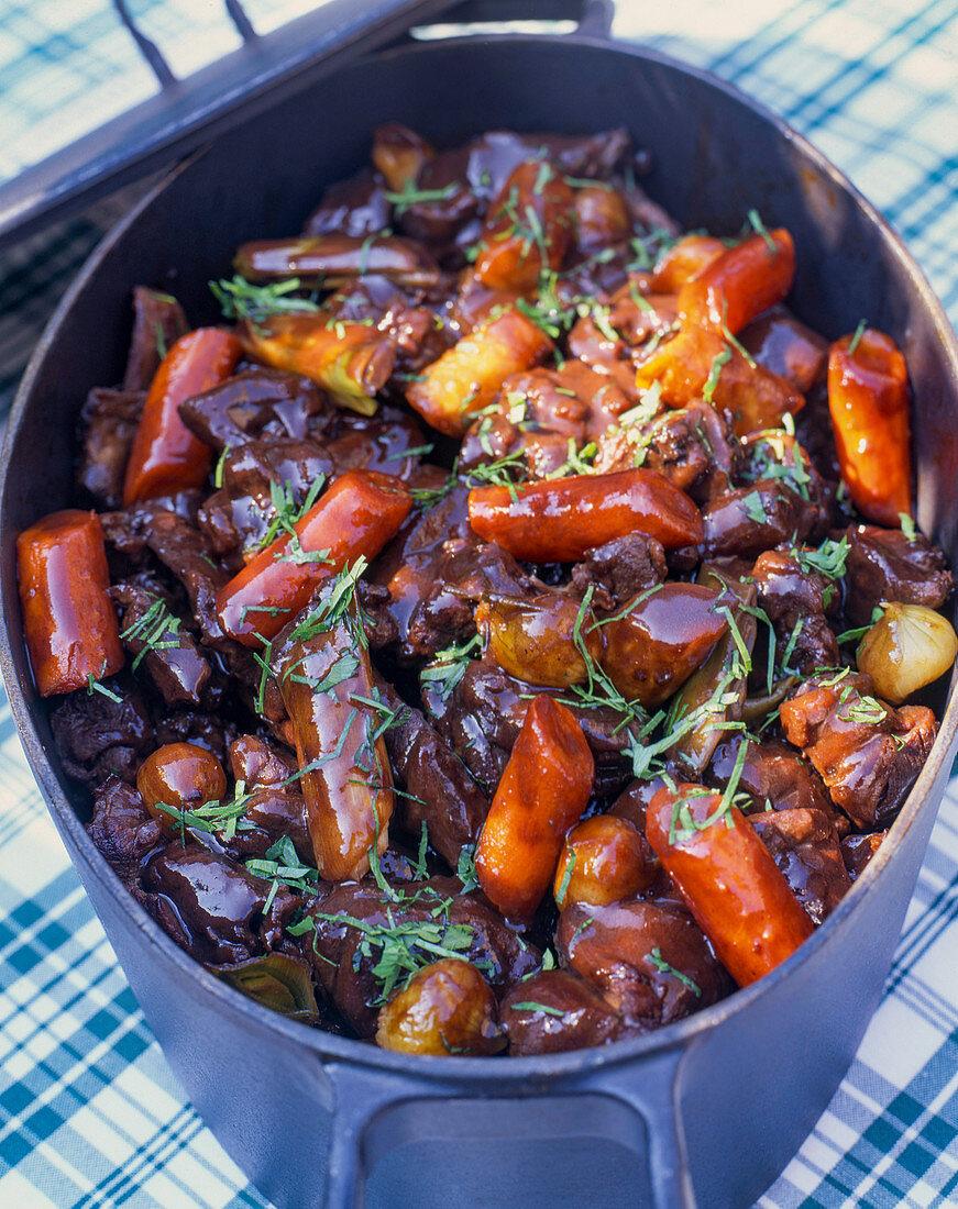 Wild boar stew in a casserole dish
