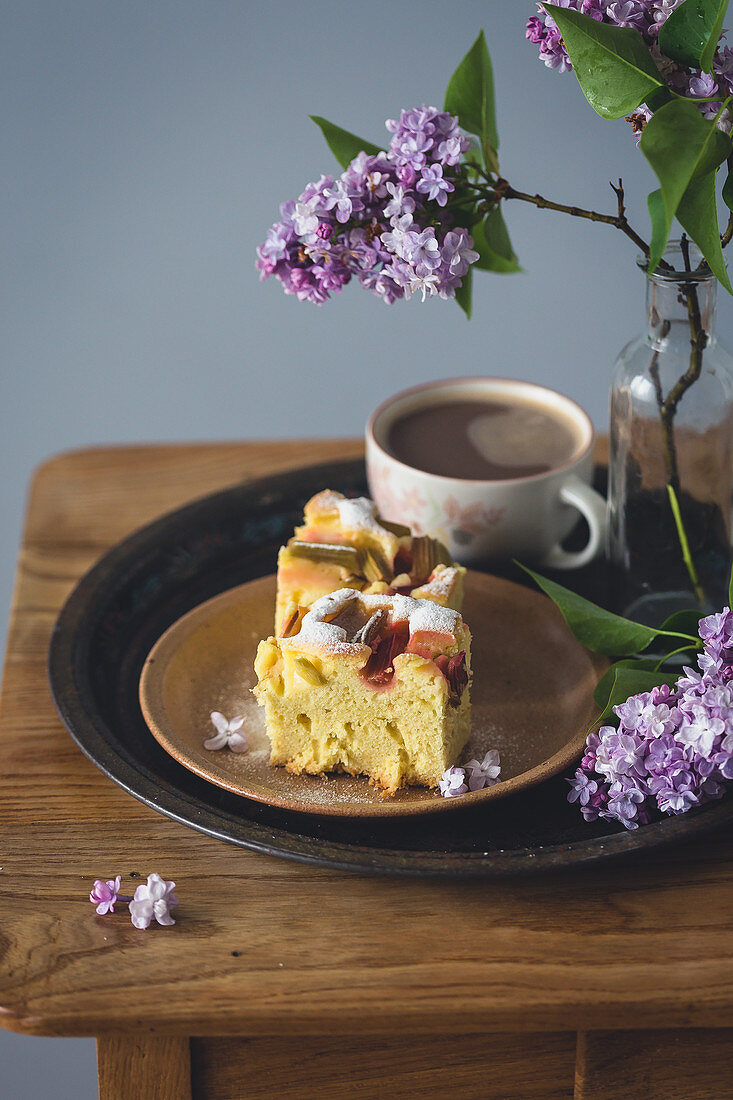 Slice of a vanilla rhubarb cake and a cup of coffee