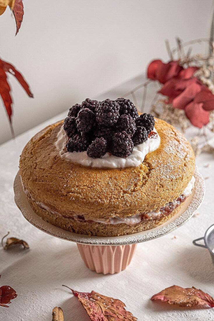 Vegan jam yogurt cake topped with blackberries