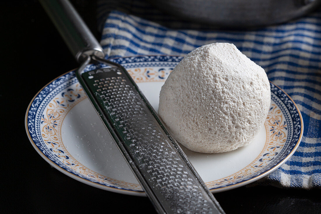 A plate with a ball of Jameed(hard dry laban made from ewe or goat's milk)