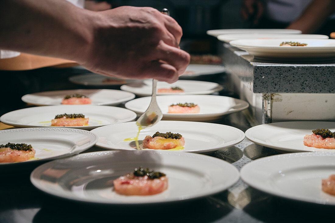 Chefs preparing dishes in French restaurant