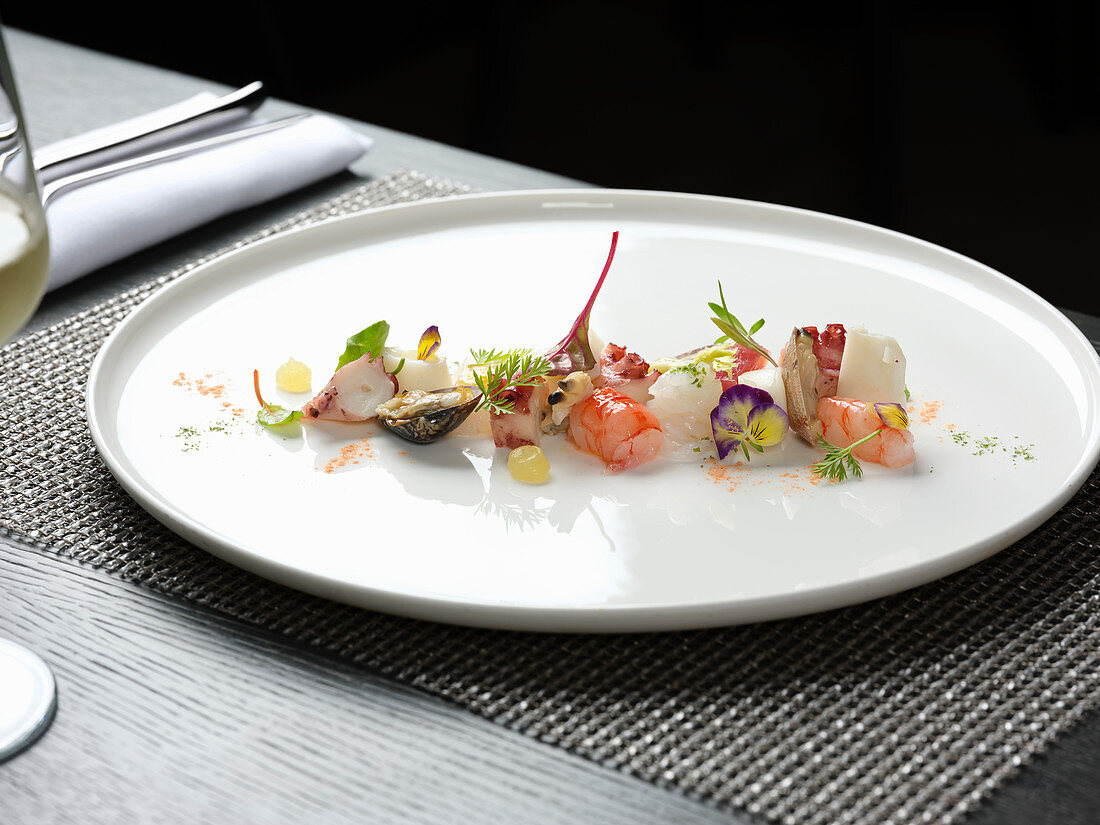 Seafood salad with herbs and flowers