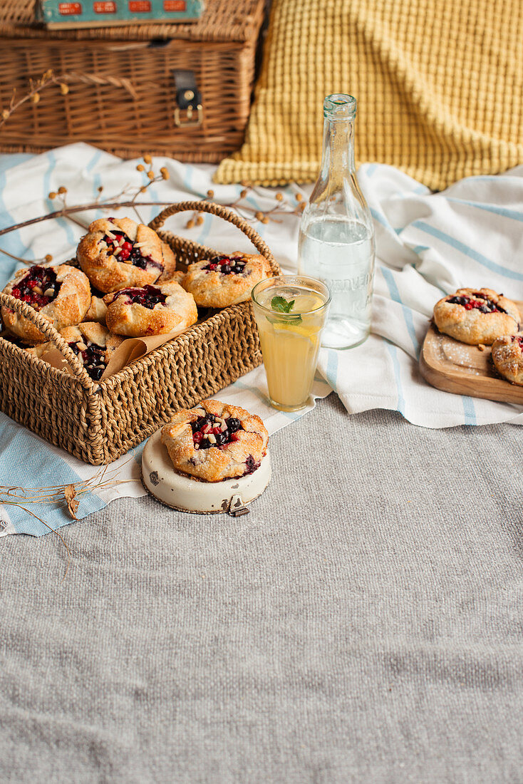 Mini summer berry galettes on a picnic blanket