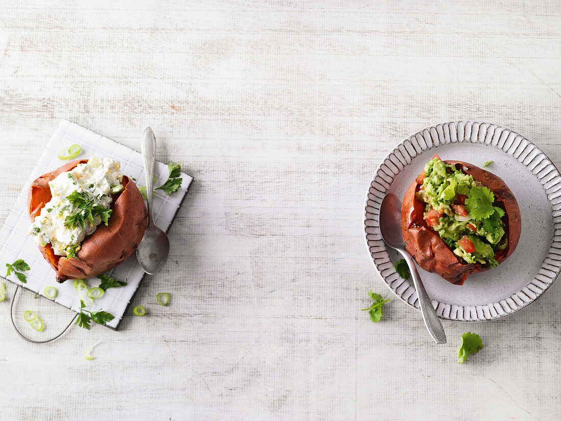 Baked sweet potato with guacamole, another with spring onion and egg dip