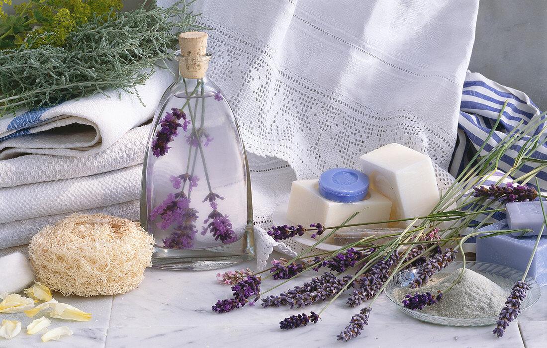 Wellness Still Life: scented oils, lavender soap, bath salts, natural sponge, lavender blossom