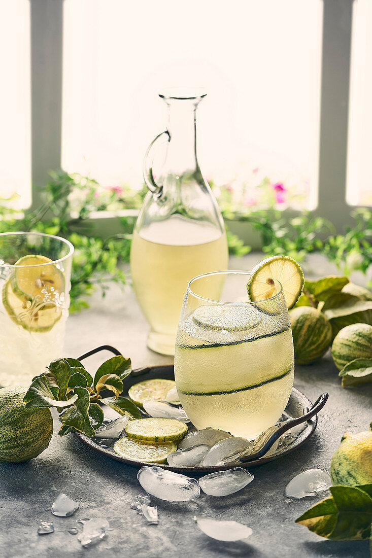 Cold lime lemonade with ice cubes