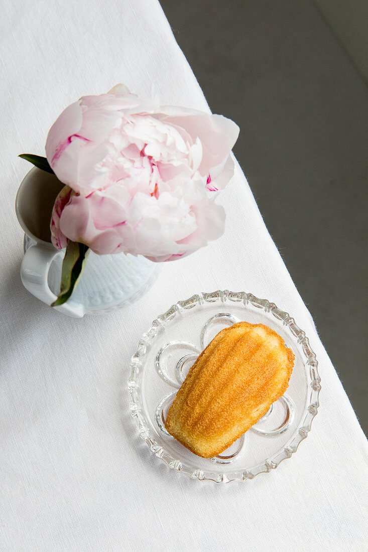 Madeleines and a vase of peonies