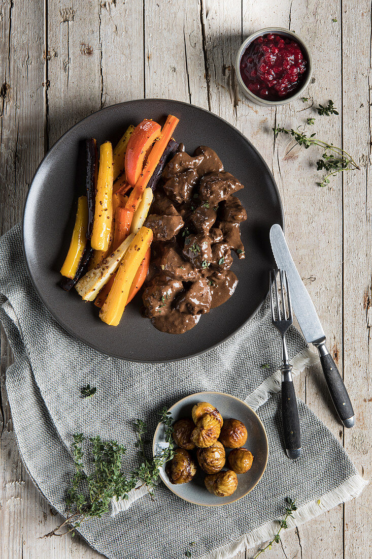 Wild boar goulash with roast vegetables, chestnuts and cranberries