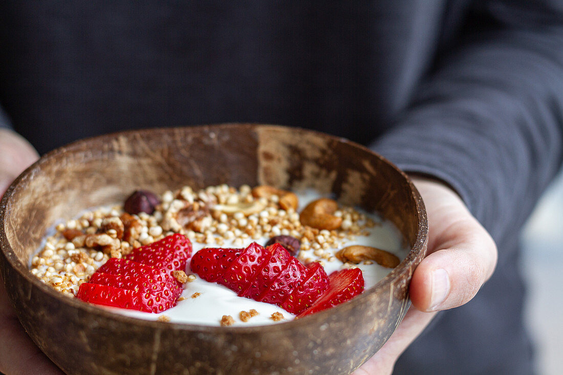 Bowl of yoghurt and granola with strawberries