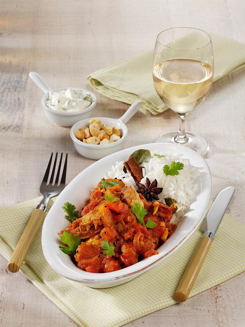 Pork tenderloin tomato curry with spiced rice