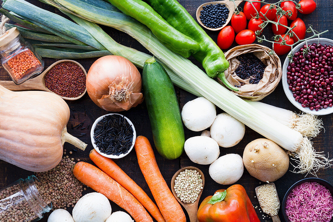 Organic vegetables and grains in bowls and jars