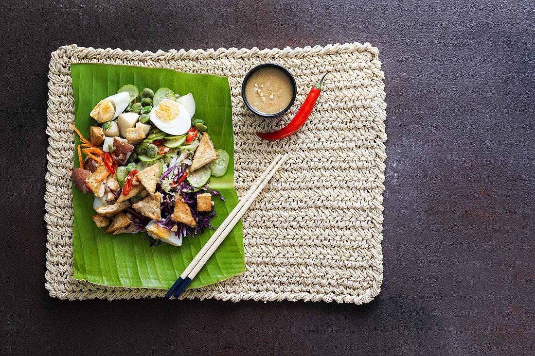 Indonesian fresh spicy salad gado gado with peanut sauce