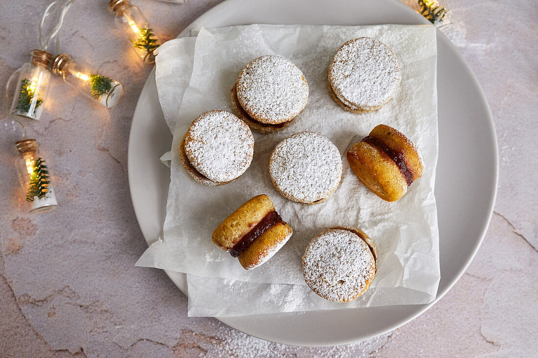 Low carb cookies with sugar free jam, sprinkled with powdered erythritol