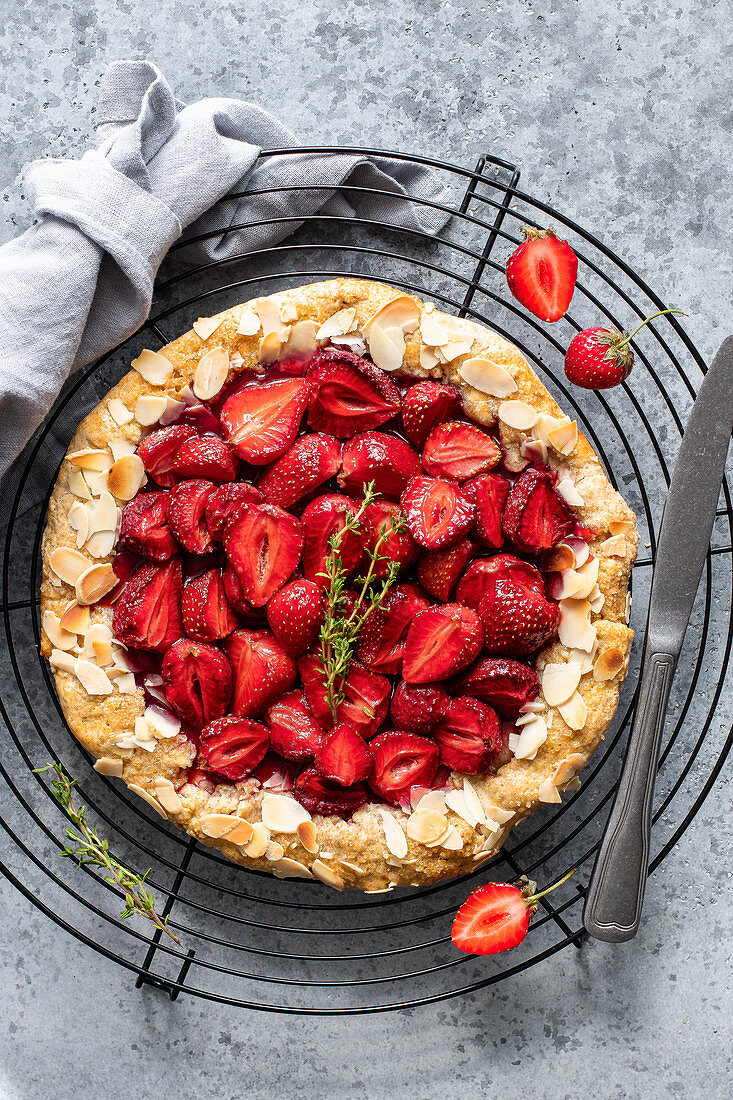 Strawberry galette with almonds on a cooling rack