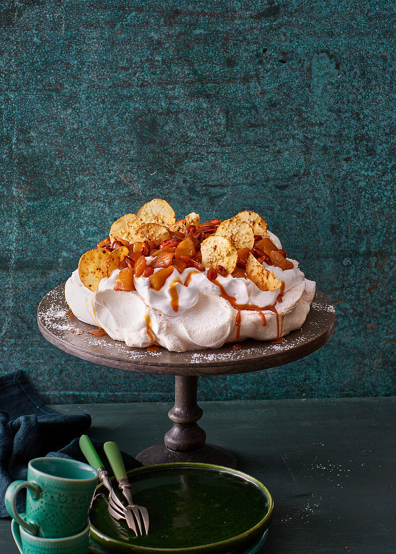 Baked apple pavlova with apple chips and caramel
