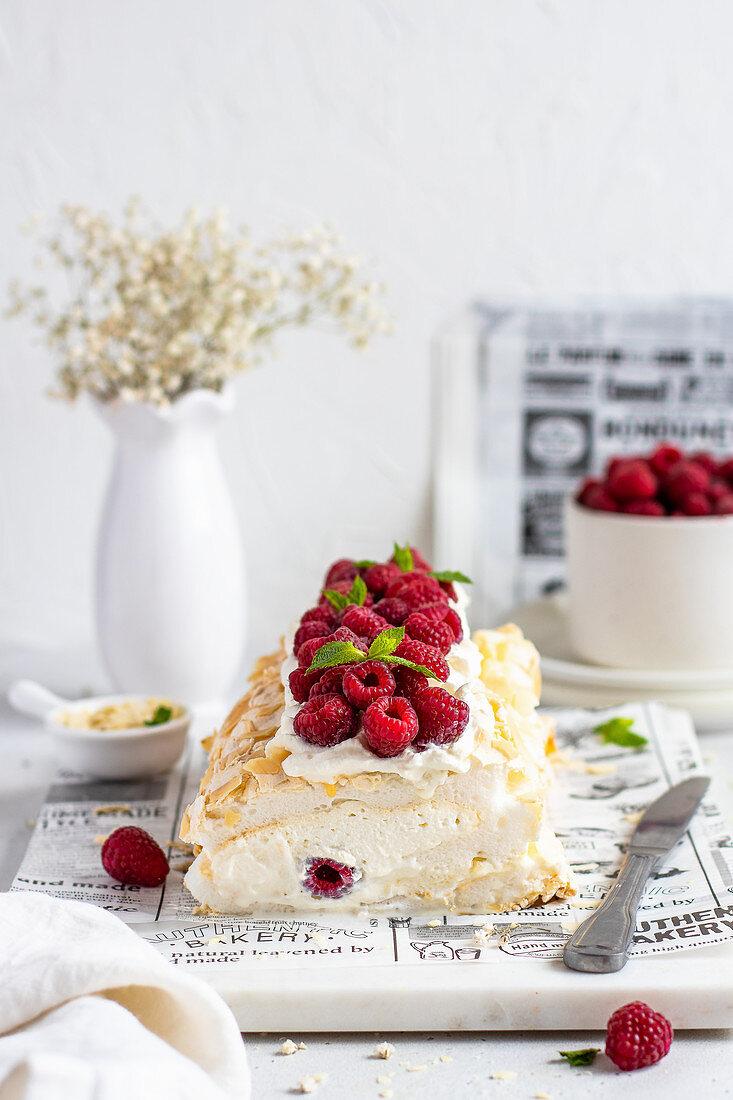 Meringue roll with mascarpone cream and raspberries