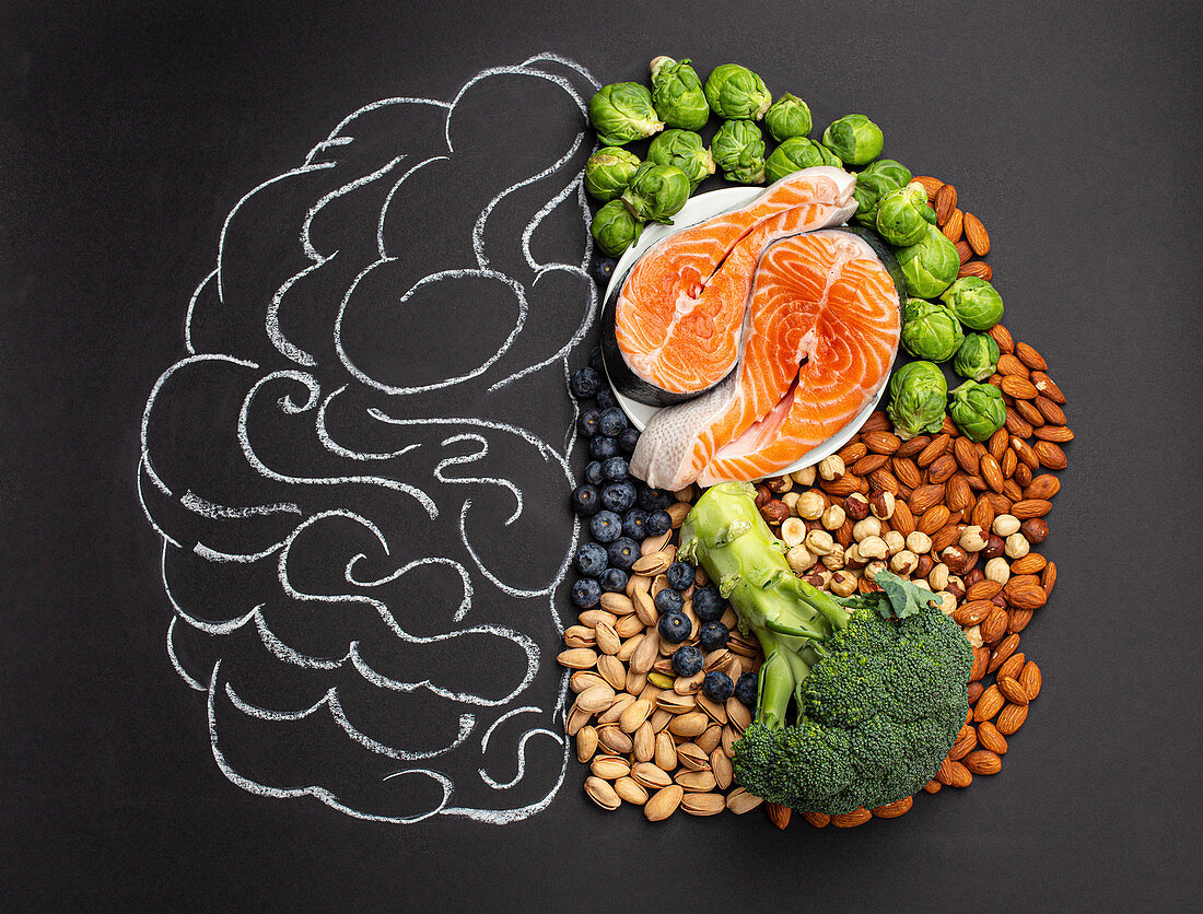 Chalk hand drawn brain with assorted food, food for brain health and good memory