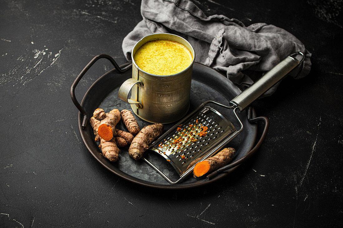 Healthy warm beverage for boosting immune system - turmeric golden milk