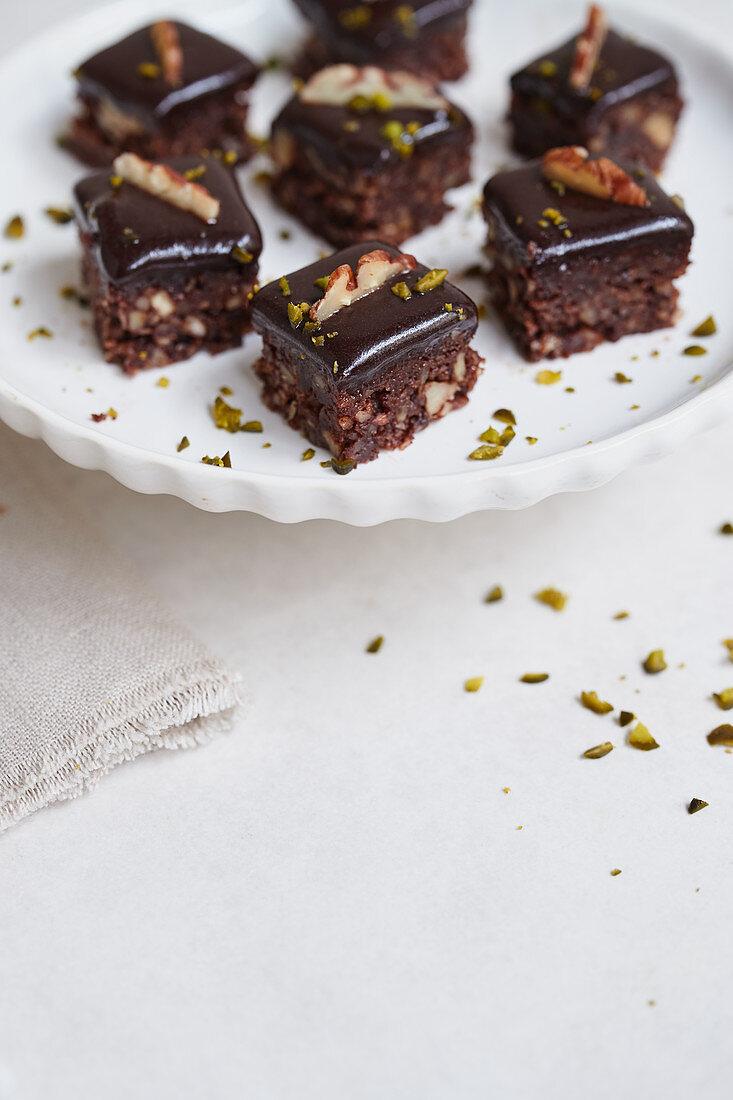 Pecan-walnut brownies with cocoa glaze