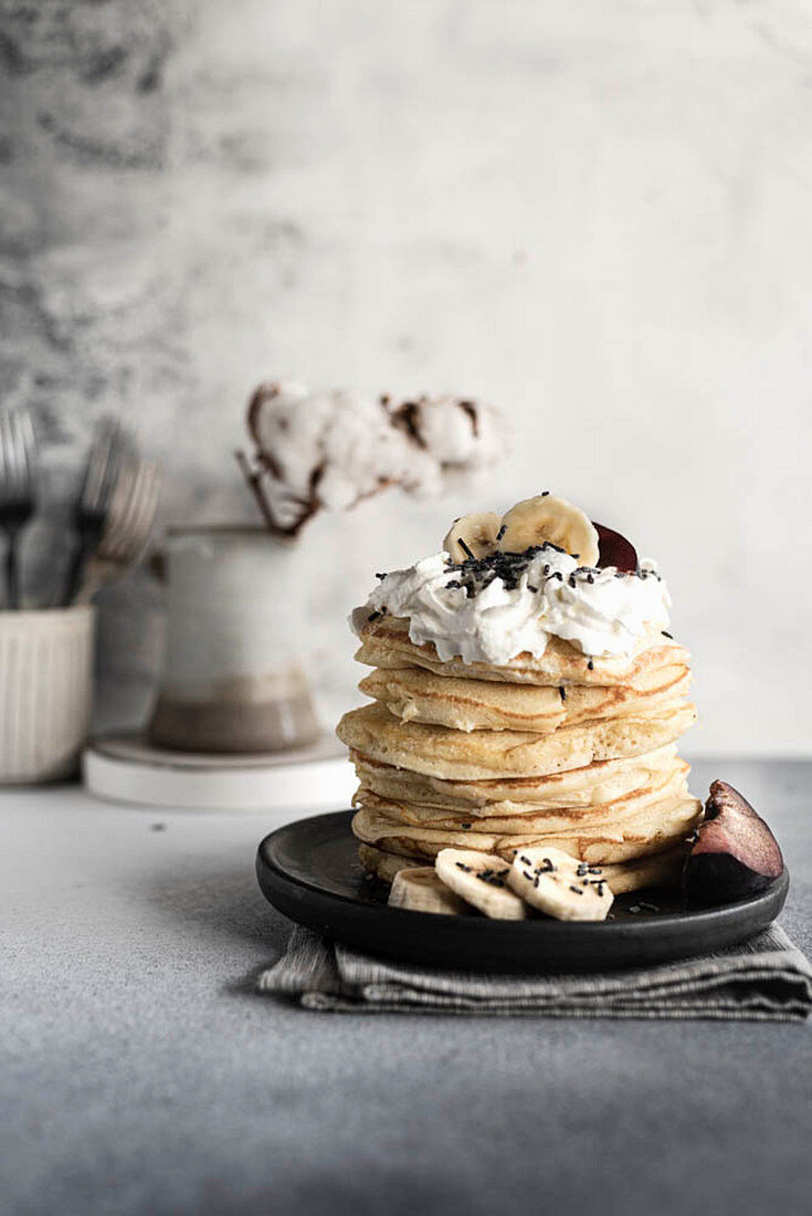Pancakes with whipped cream and bananas