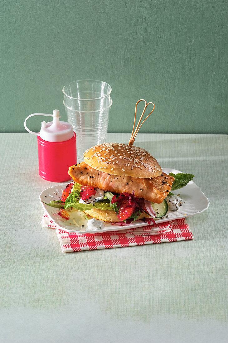 Salmon burger with vegetables and yogurt sauce