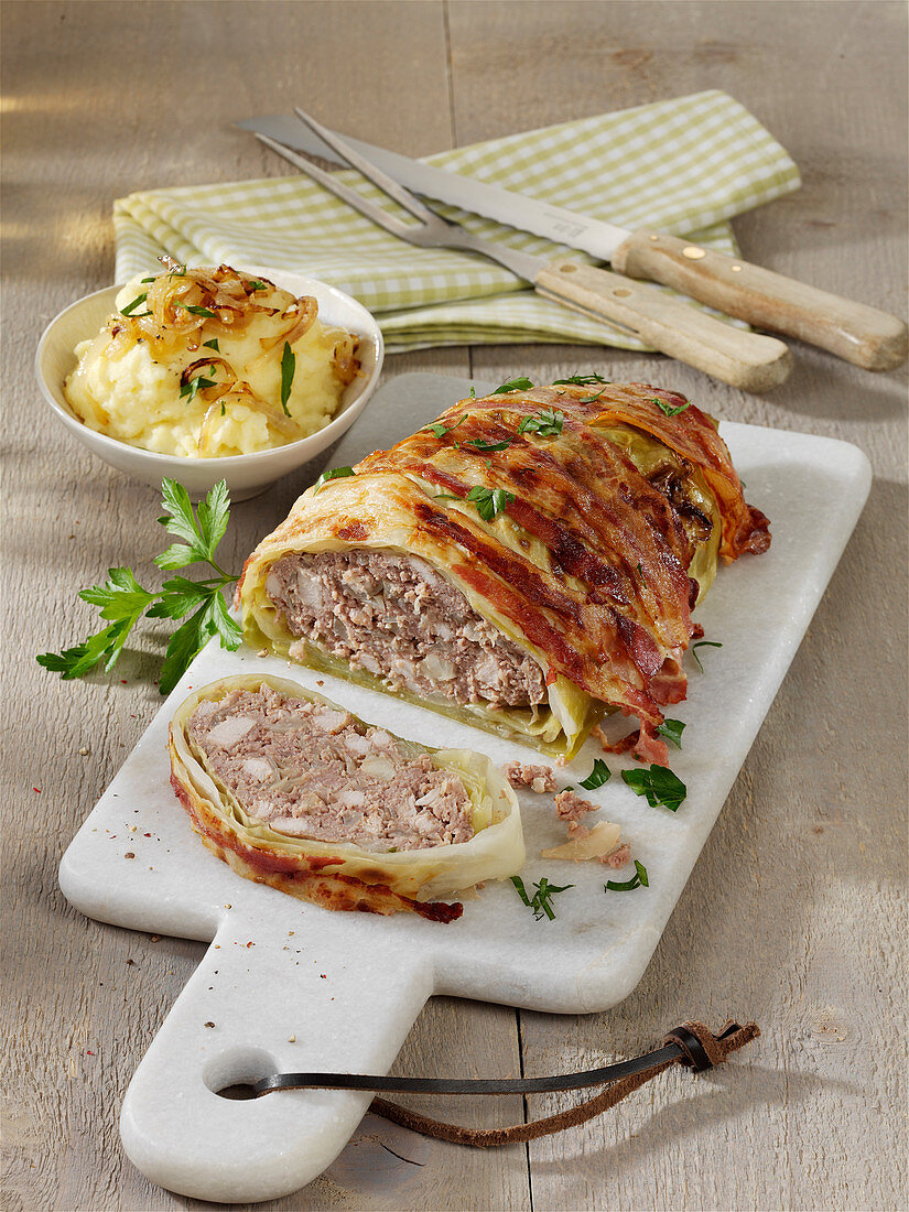 Meatloaf in a cabbage and bacon coat
