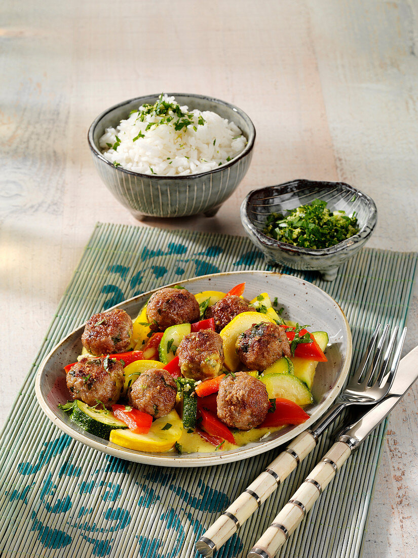 Asian meatballs with vegetables and rice
