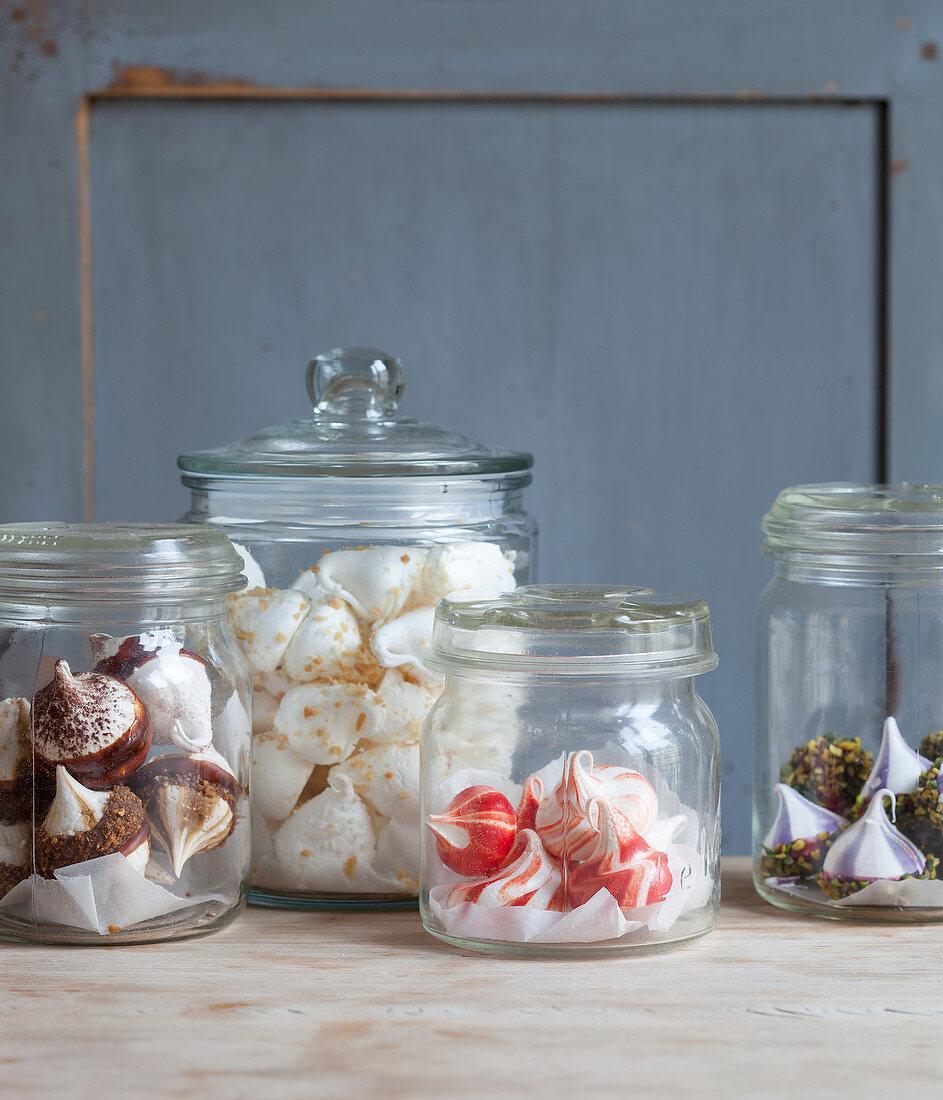 Various meringue drops in storage jars