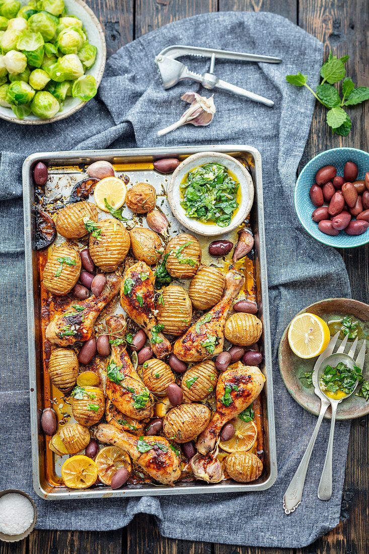 Chicken drumsticks and hasselback potatoes with gremolata