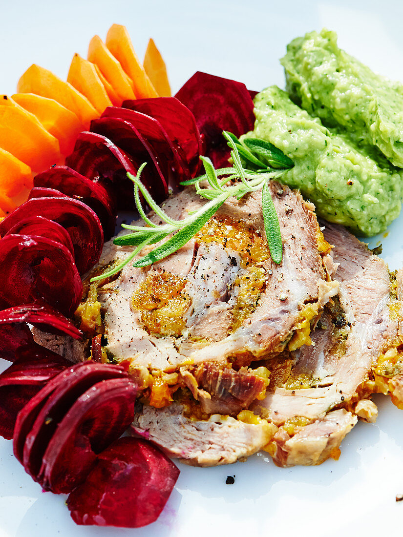 Roast pork with apricot and herb filling and dill and avocado cream