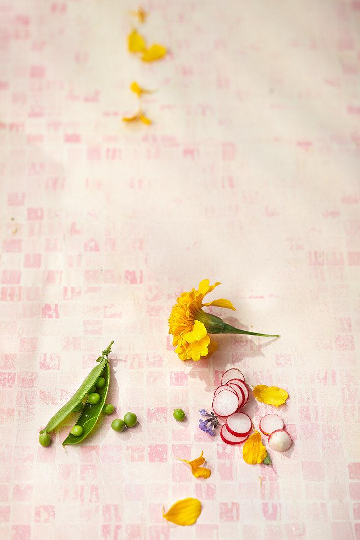 Pea pod, radish slices and edible flowers